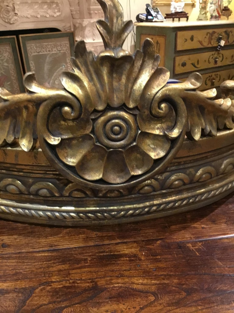Architectural French style carved gilt composition crown/cornice, with foliate and Spiral twists motif. Antique gold finish. It has a bracket for hanging in the back. Great centerpiece for draping a bed.
