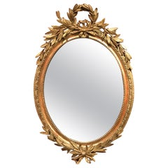 French Gilt Foliate Decorated Oval Wall Mirror, Early 19th Century