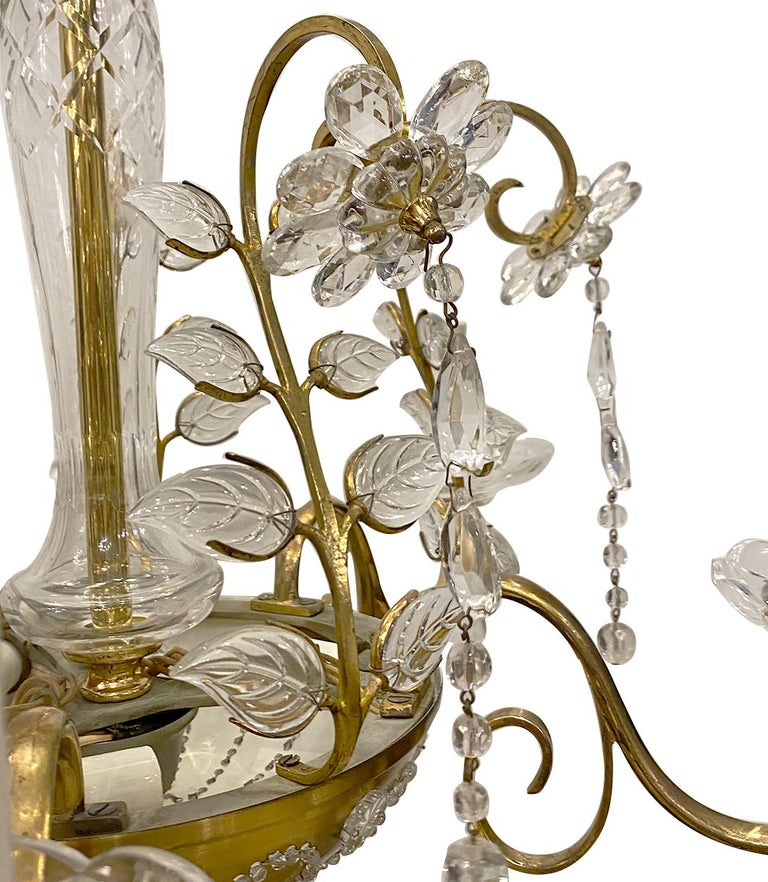 A circa 1920s French gilt metal chandelier with molded glass leaves and crystal flowers.  Measurements: Minimum drop: 25