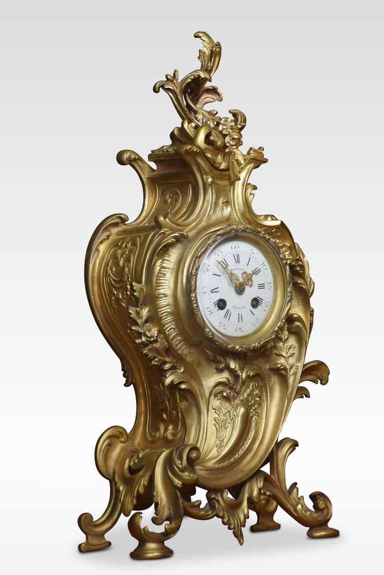 Late 19th century French gilt metal mantel clock, the white enamel dial Roman numerals, signed Bornand Marseilles. enclosing a two-train movement striking on a bell. Enclosed in cast foliate swept case. Dimensions: Height 19 inches Width 9