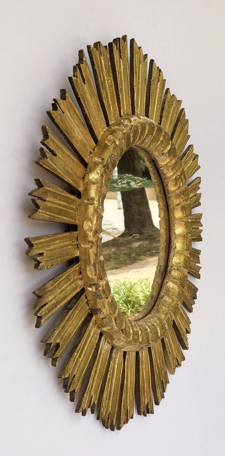 A lovely French gilt sunburst (or starburst) mirror, 21 inches diameter, with round mirrored glass centre in moulded frame.