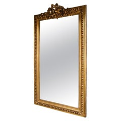 French Gilt Wood Wall Mirror with Dove's Ribbon and Foliage Cartouche Circa 1820