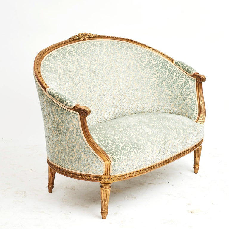 French Canapé sofa in Louis XVI style, circa 1860. Original hand carved giltwood. Age-related patina. Newly upholstered with Aquamarin fabric from Colefax & Fowler.
