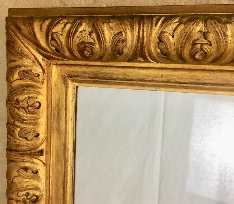 A large rectangular French mirror with gilt undulating and rope design, 20th century. Can be hung vertically or horizontally.