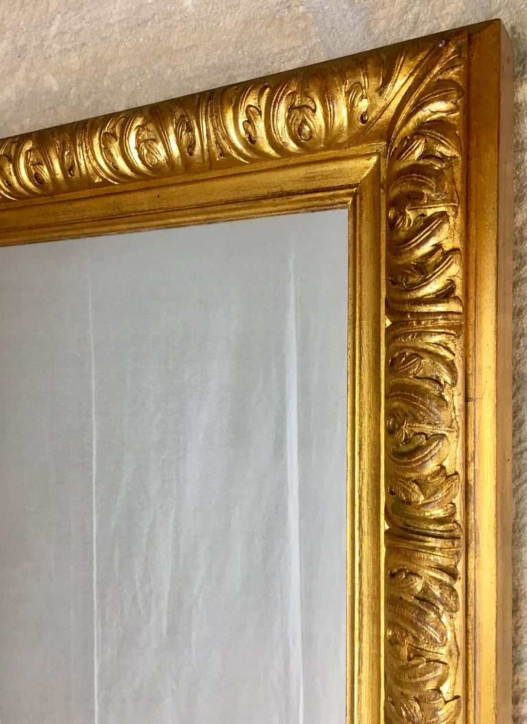 Carved Large French Giltwood Wall or Mantel Mirror For Sale