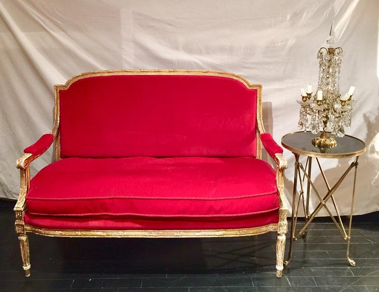 Frenchgiltwood settee sofa, style Louis XVI, red velvet, 19th century   Dimensions: 53.5 in. L 25 in. D x 39.5 in. H Seat height 20 in.