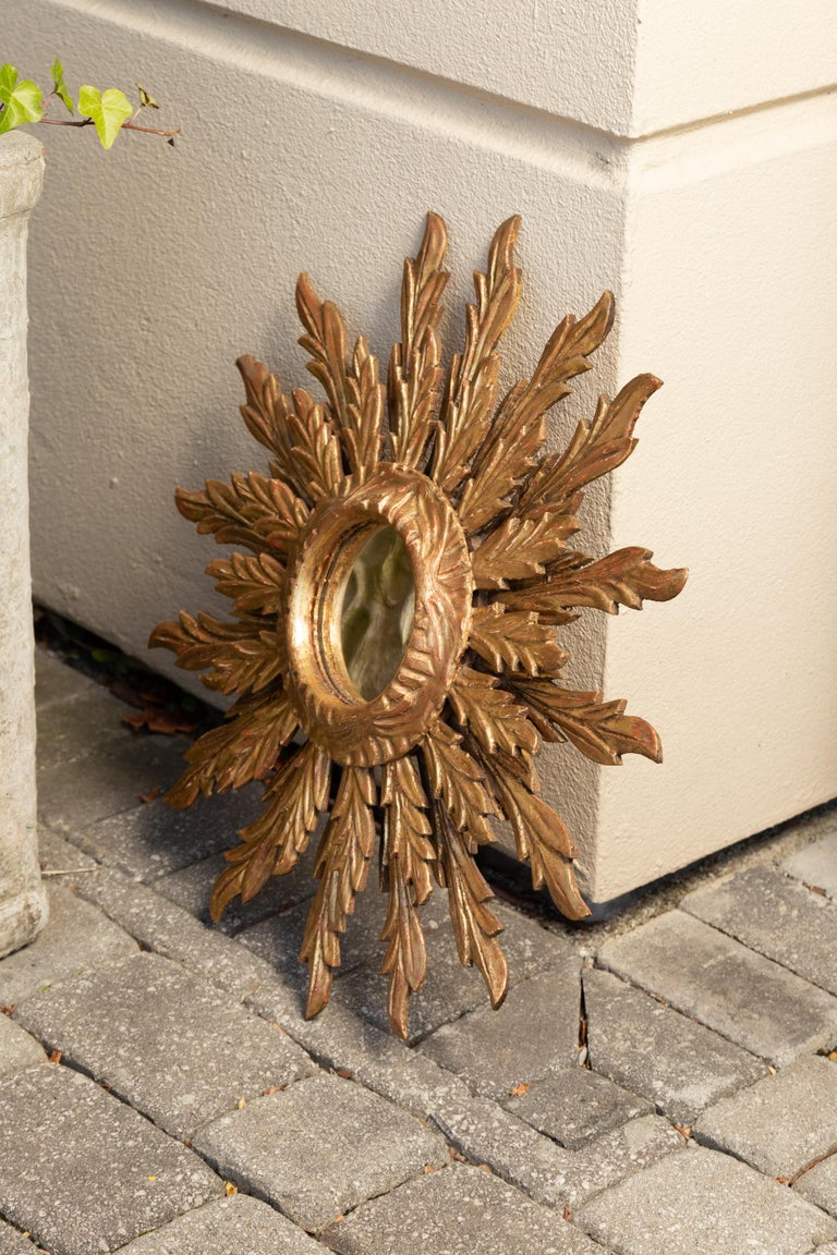 French Giltwood Sunburst Mirror with Wavy Sunrays from the Mid-20th Century In Good Condition For Sale In Atlanta, GA
