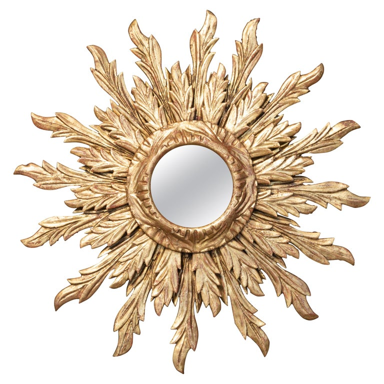 French Giltwood Sunburst Mirror with Wavy Sunrays from the Mid-20th Century For Sale