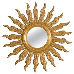 French Giltwood Sunburst Mirror with Wavy Sunrays from the Mid-20th Century
