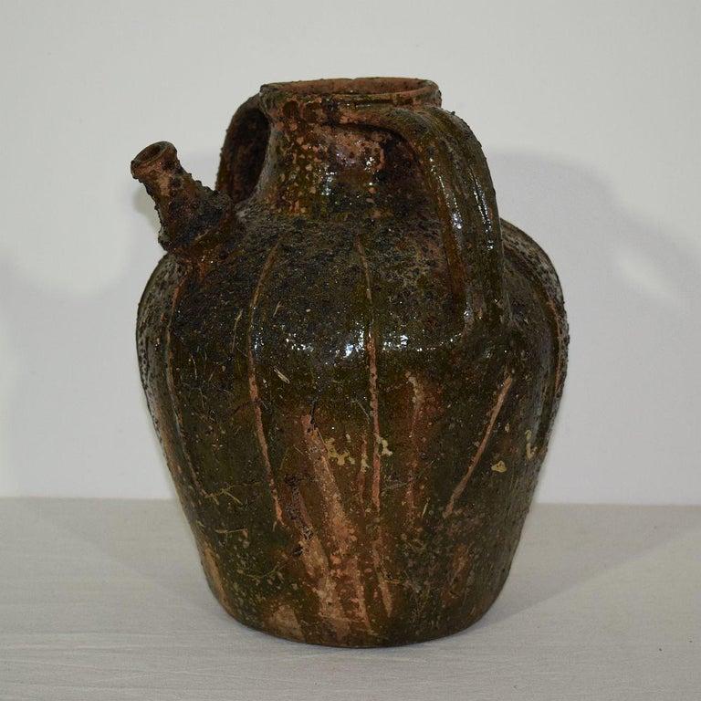 Rustic French Glazed Terracotta Walnut Oil Jug, 18th Century For Sale