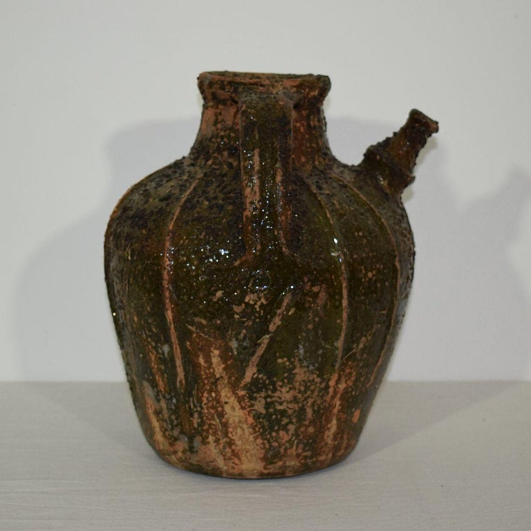 18th Century and Earlier French Glazed Terracotta Walnut Oil Jug, 18th Century For Sale