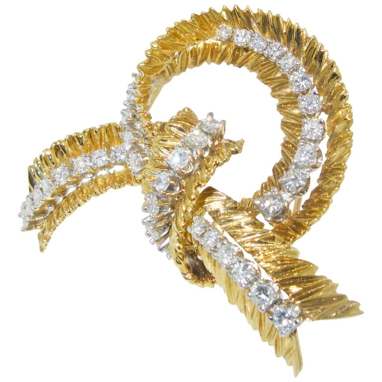 French brooch of a Stylized bow  with fine white brilliant cut diamonds, the 37 diamonds weigh an estimated 1.67 cts.  These diamonds are all well matched, well cut and near colorless (G/H) and VS (very slightly included).  This French brooch is 18K