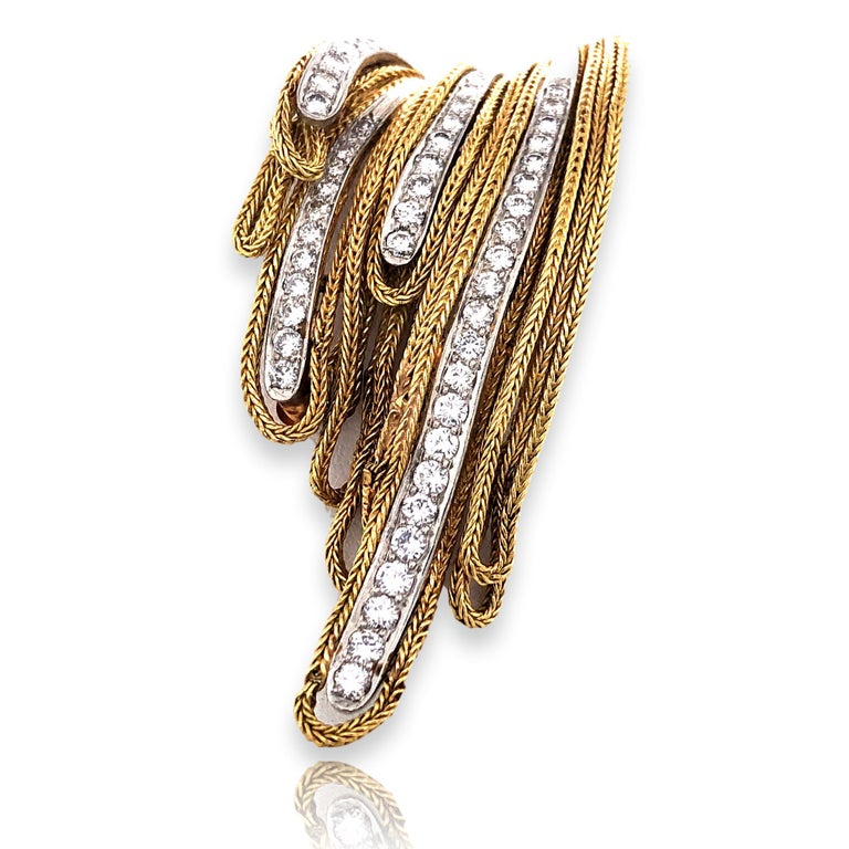 Gold and diamond French made brooch. The 18k yellow gold 2 3/8