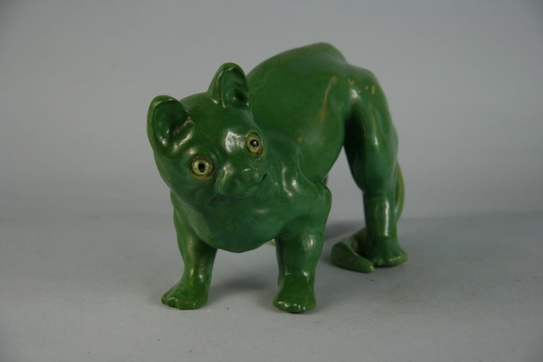3-635 French ceramic cat with green glass eyes.