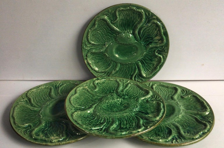 French green Majolica oyster plate signed Aetgina Vallauris, circa 1950. With an octopus pattern.
