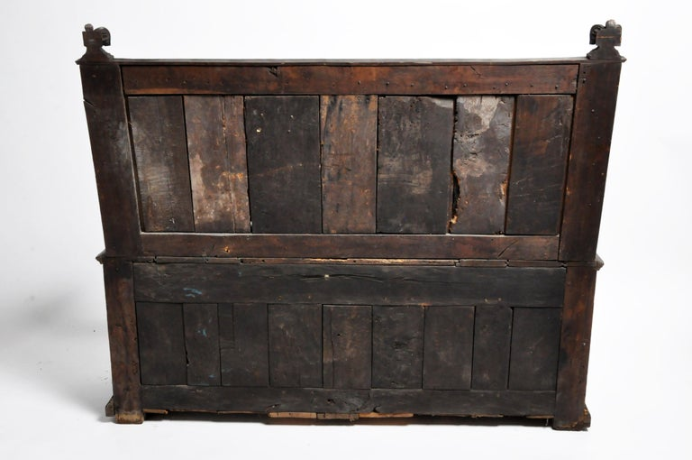 This 17th century oak bench is richly carved with Gothic motifs. Despite its age, the piece has a very solid frame with relatively minor damage. Boards show the evidence of very old tools and techniques. All joinery is by mortise-and-tenon, secured