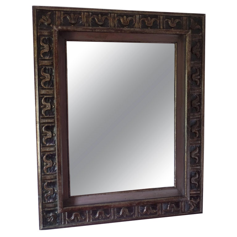 French 1940 wall mirror / frame in the modern neoclassical spirit with carved fleur d'lys motifs and Doric columns arranged sequentially around the border of the frame. The frame is highlighted with subtle silver and gold leafed details against a