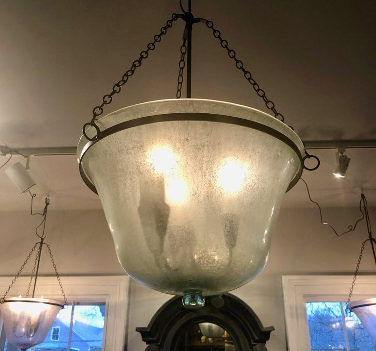 We have always had a thing for hand blown French garden cloches that come in two configurations, bell form and melon form. This one is a melon cloche (a little shorter and wider than a bell cloche) and it has been converted into a hanging light with