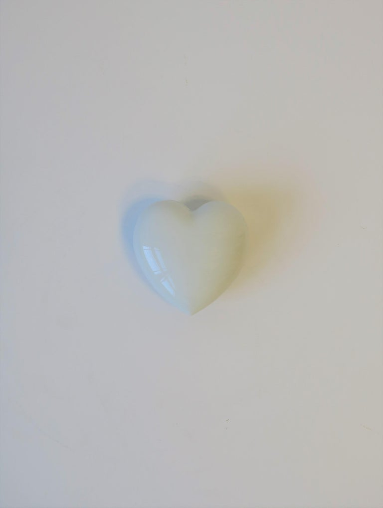 A French white porcelain heart jewelry box. Marked on bottom, 'France', Limoges'. Box is great for a vanity, nightstand, desk, etc.   Piece measures: 1.75