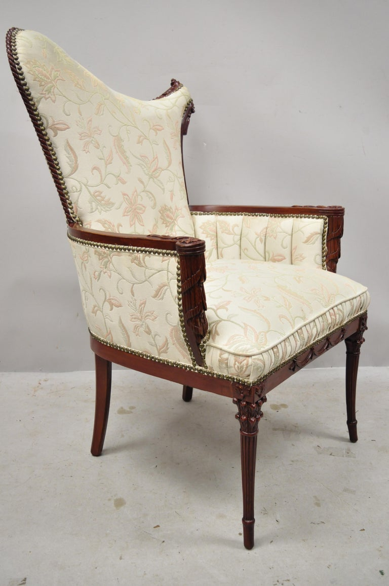 French Hollywood Regency Dorothy Draper style carved tassel fireside mahogany armchair. Item features drape and tassel carved frame, Corinthian column legs, solid wood frame, nicely carved details, tapered legs, great style and form, circa early