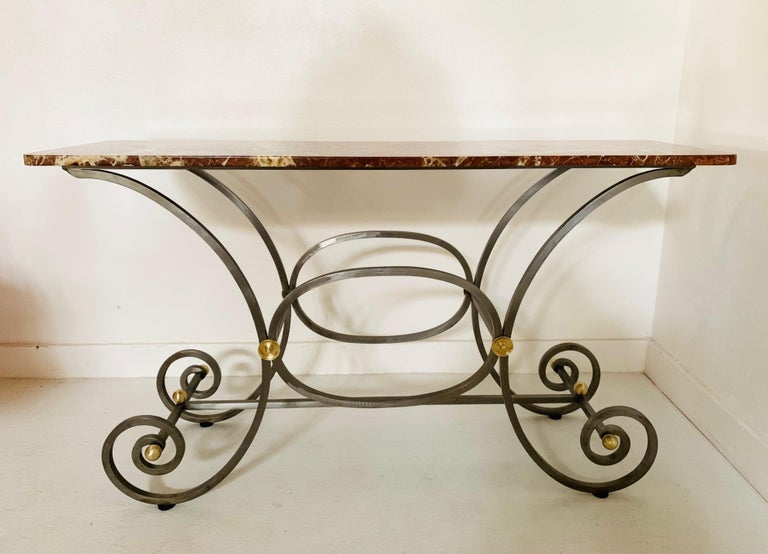 French iron and marble-top console. Base has a nice scrolled pattern with bronze round accents. Can also be used as a baker's table.