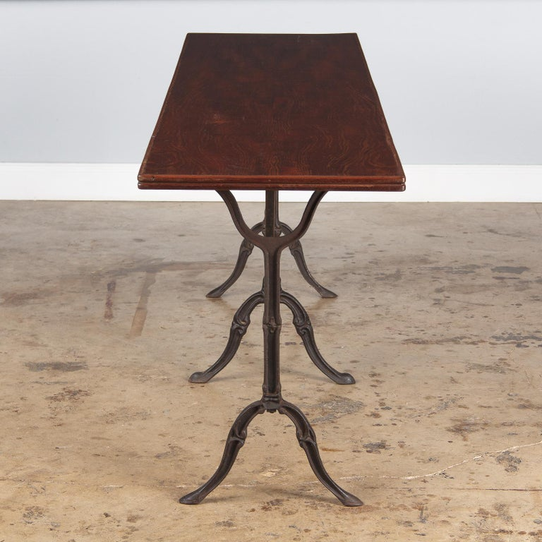 French Iron Base Bistro Table with Lacquered Wooden Top, 1920s For Sale 7