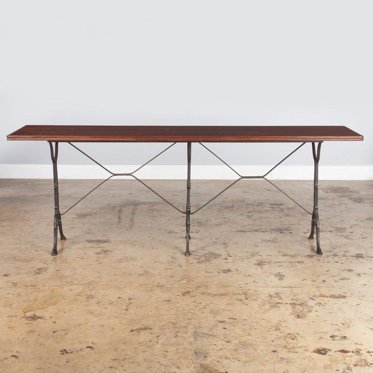 French Iron Base Bistro Table with Lacquered Wooden Top, 1920s For Sale 8