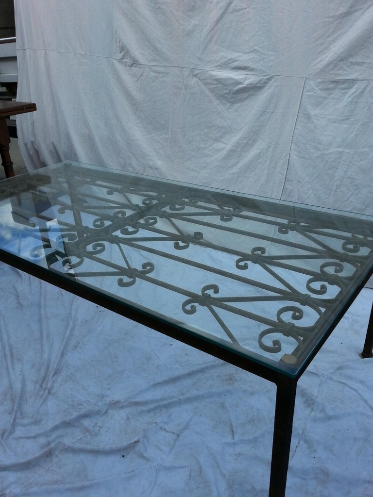 French iron coffee table with glass top.