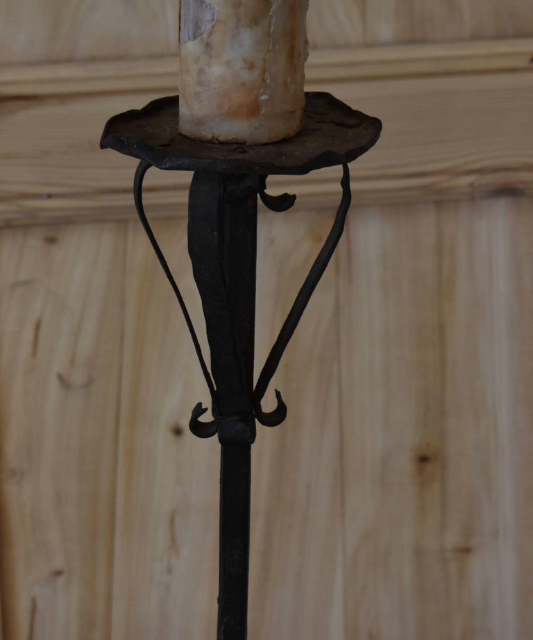 Great smaller French iron torchiere floor lamp with old aged iron patina. Simple scroll work design on stem and candle top. Measures: 47
