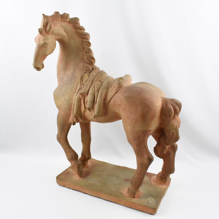 Fine French 1940s terracotta sculpture by Jan de Monpesat (France, 20th Century). Superb animal sculpture, original patina, and stylishly designed horse, hand-signed incised J. DE MONPESAT signature on the plinth base. Great surface finish with