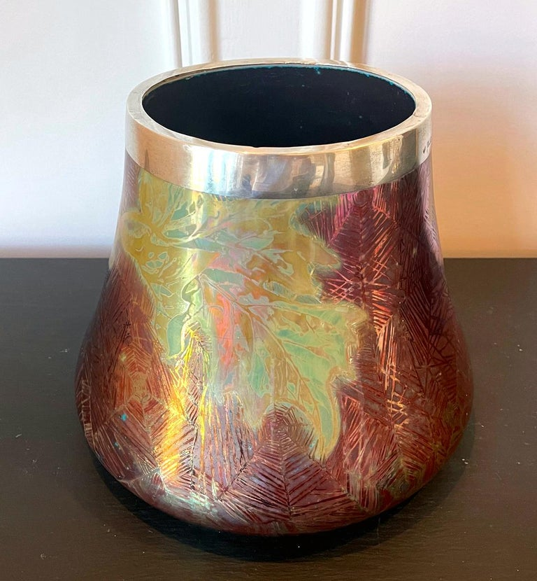 A ceramic vase with iridescent glaze in the shape of an elephant foot cache pot by the legendary French ceramist Pierre Clement Massier (1845-1917). Massier is widely considered as the founder the modern ceramic industry of Vallauris, Southern