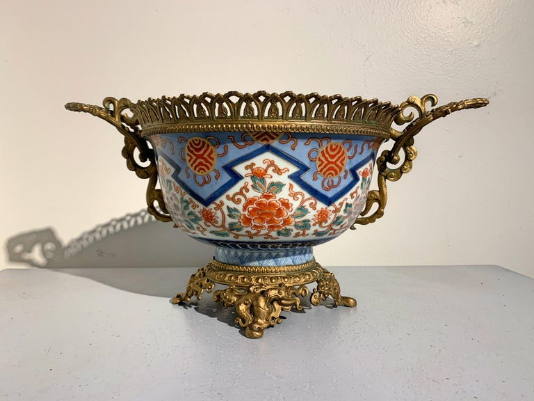 An elegant French Louis XVI style Japonisme centerpiece comprised of a large 19th century Meiji Period Japanese Imari Porcelain bowl with French gilt metal ormolu mounts, late 19th-early 20th century, France and Japan. 