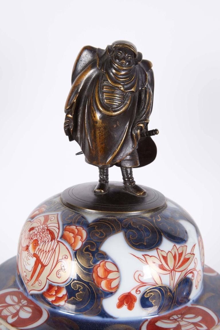 19th Century French Japonisme Parcel-Gilt Patinated Bronze Imari Porcelain Clock Garniture For Sale