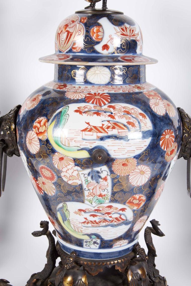 French Japonisme Parcel-Gilt Patinated Bronze Imari Porcelain Clock Garniture For Sale 2