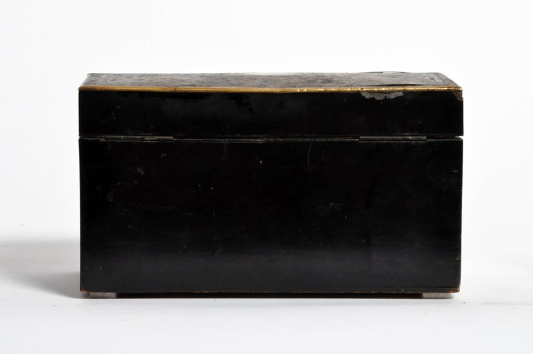 This finely made box features a polished lacquer surface, brass fittings, and two interior compartments. Made circa 1900, wear is consistent with age and use.