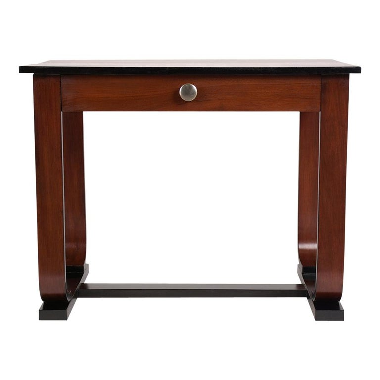 This 1960's French Art Deco Writing Table has been completely restored, is made out of mahogany, and has been stained a rich mahogany & ebonized color combination with a newly lacquered finish. This side table comes with a single top drawer with a