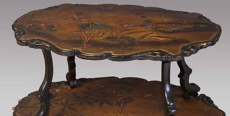 French lacquered two-tier table circa 1880 With birds in a landscape decoration.
