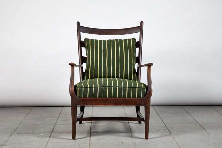 French ladder back armchair upholstered in green and natural striped African fabric.