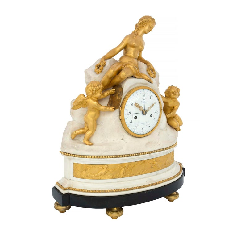 An incredible and extremely high quality French late 18th century Louis XVI period ormolu, white Carrara marble and black Belgian marble clock signed Déliau - Rue De La Bartillerie No. 24 A Paris. The clock is raised by etched topie shaped ormolu
