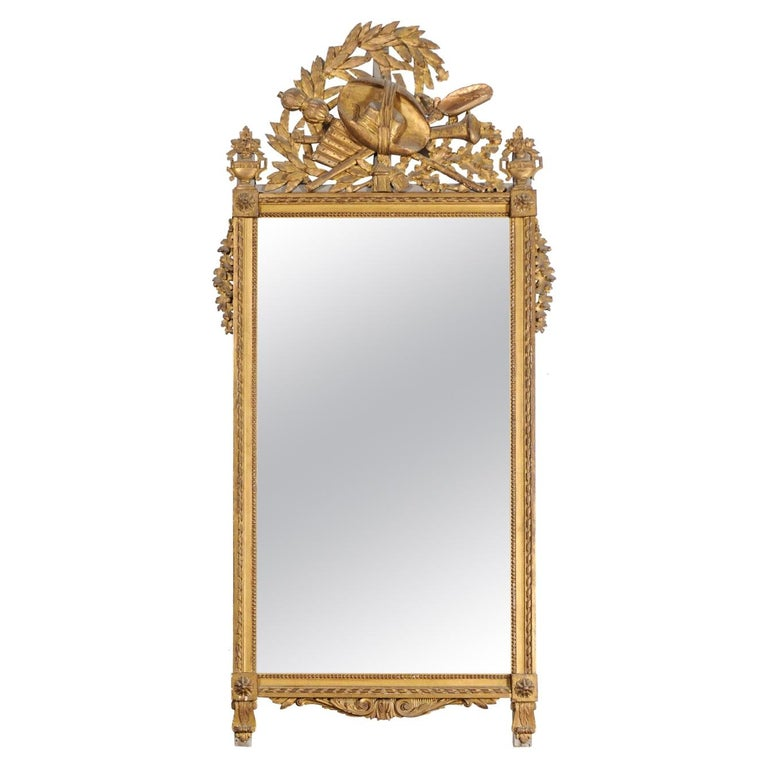French Late 18th Century Louis XVI Period Giltwood Mirror with Carved Crest For Sale