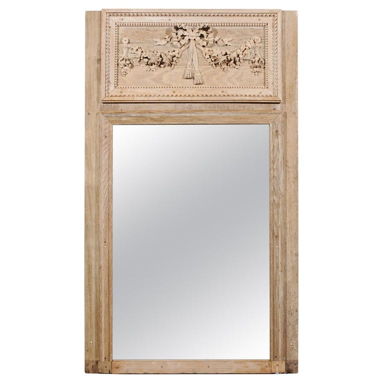 French Late 18th Century Louis XVI Trumeau Mirror with Carved Bow and Flowers For Sale