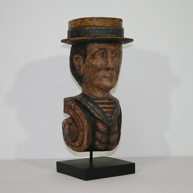 Beautiful Folk Art object representing the head of a sailor. France, circa 1880-1900. Weathered, small losses and old repairs.