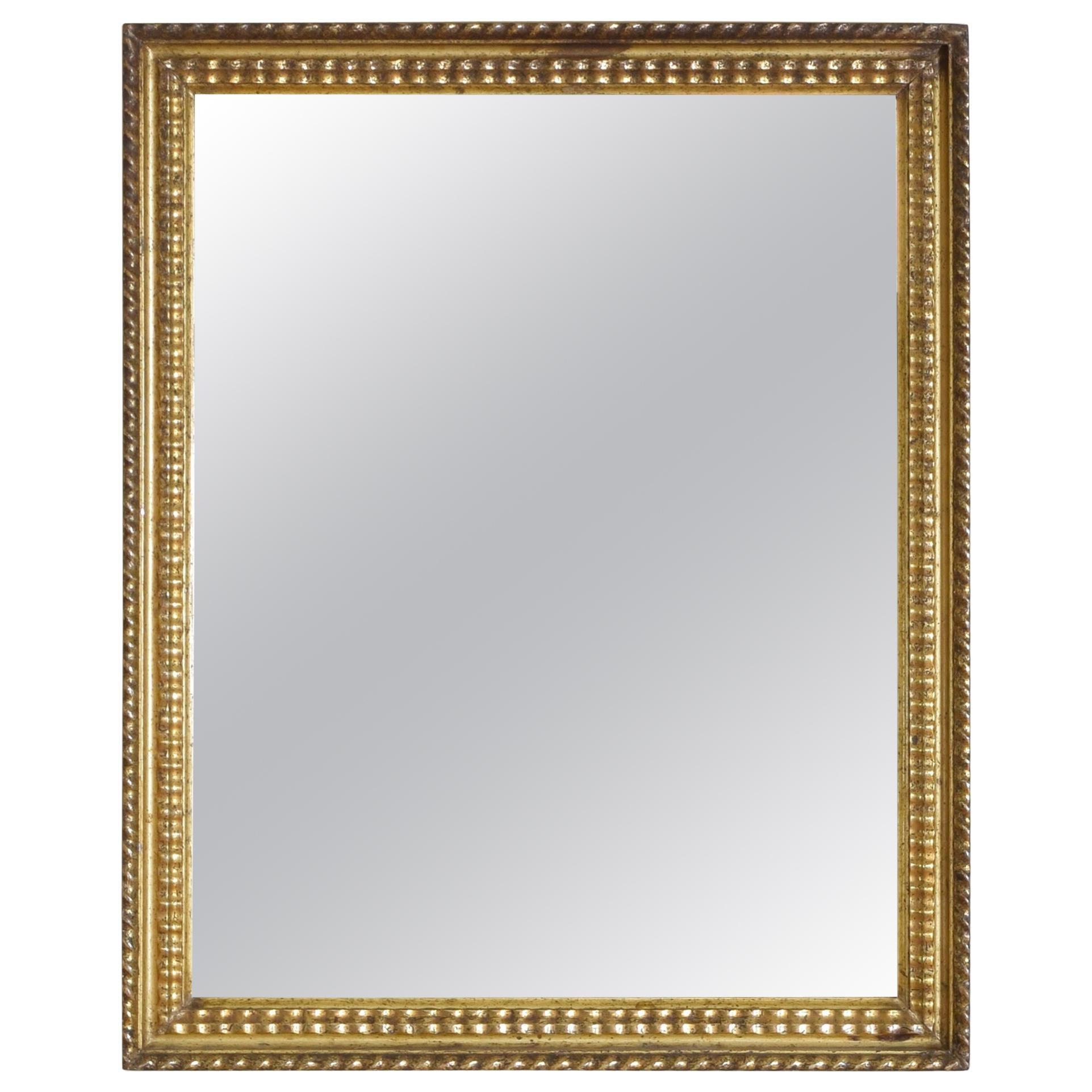 French Late Neoclassic Carved Giltwood and Gilt Gesso Mirror, Mid 19th Century