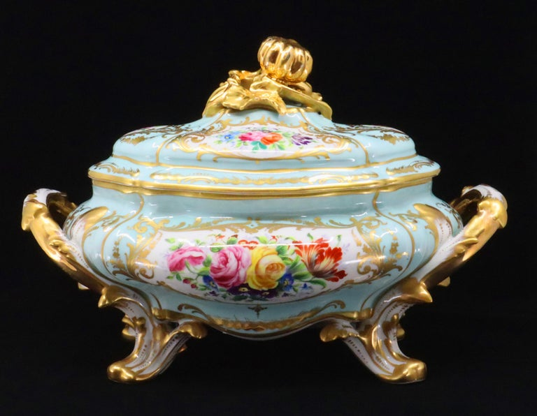 This French Le Tallec parcel-gilt blue-celeste ground porcelain soupière with lid and tray from the mid-20th century has an oval shape and is in the Rococo style. The piece is in the Sèvres style with an oval bombe body centring sides of Rocaille
