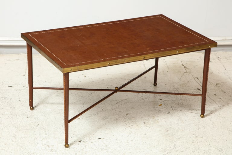 French stitched leather and bronze coffee table in the manner of Adnet.