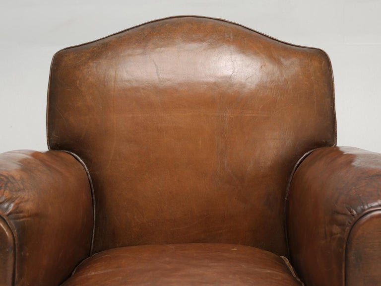 French Art Deco leather club chair that was restored by our own, old plank upholstery department. Our upholsters, carefully open each and every club chair, that enters their workshop and begin the laborious and conscientious process, of determining,