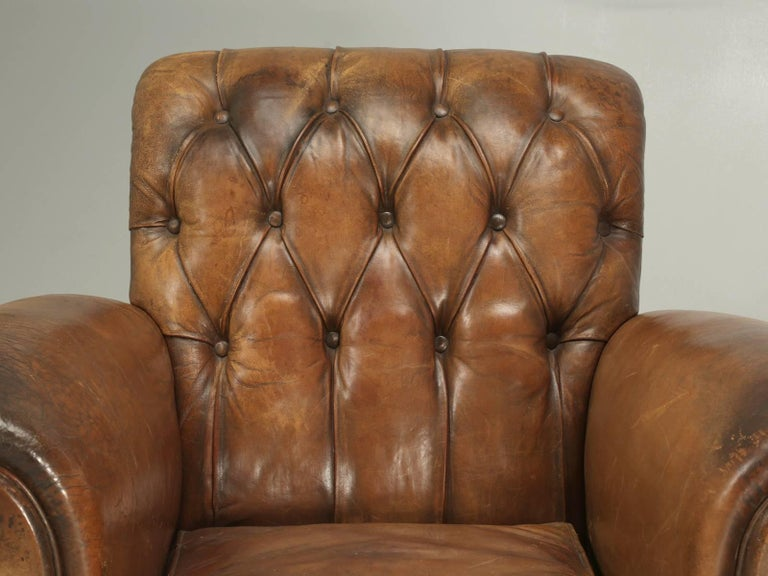 Another extremely rare pair of original French leather club chairs, with their tufted leather backs, that our old plank upholstery department, has painstakingly completely gone through the frames (while never touching the leather) and rebuilt to