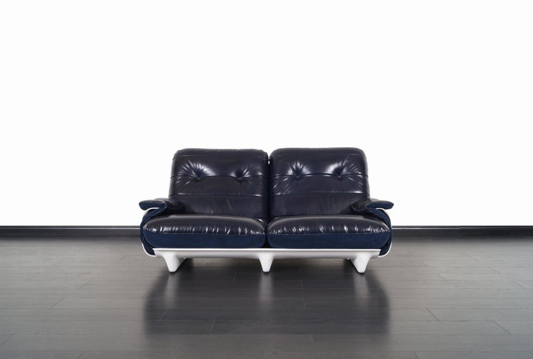 A beautiful vintage modernist sofa designed by Michel Ducaroy for Ligne Roset in France, circa 1970s. This loveseat is from the