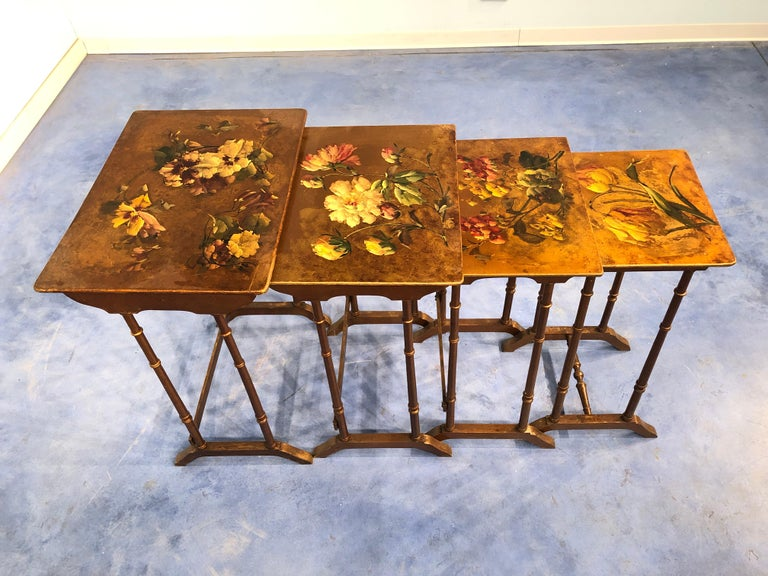 An astonishing batch of 4 coffee tables, on the top decorated with floral painting in the Liberty style. You can see also legs in bamboo shape, a characteristic element from the period.   Originals of the era, no reproductions. In very good