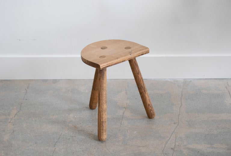 Vintage light oak stool with beautiful tripod legs from France. Original wood finish with great age markings and patina. Can be used as a small stool or as side table next to chairs.